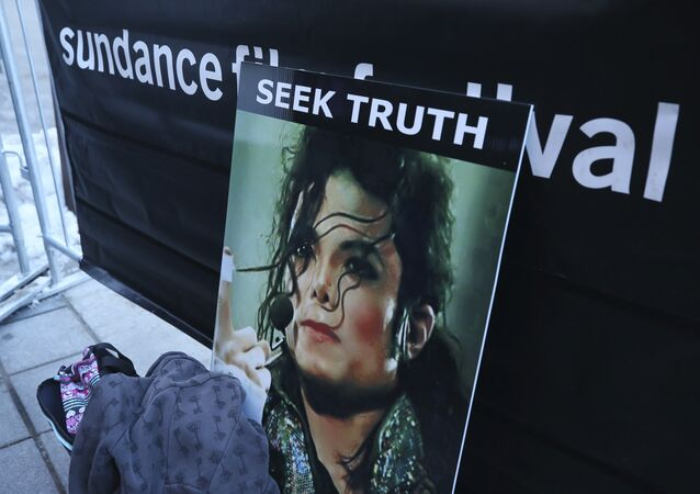 A sign in support of Michael Jackson is seen outside of the premiere of the Leaving Neverland Michael Jackson documentary film at the Egyptian Theatre on Main Street during the 2019 Sundance Film Festival, Friday, Jan. 25, 2019, in Park City, Utah