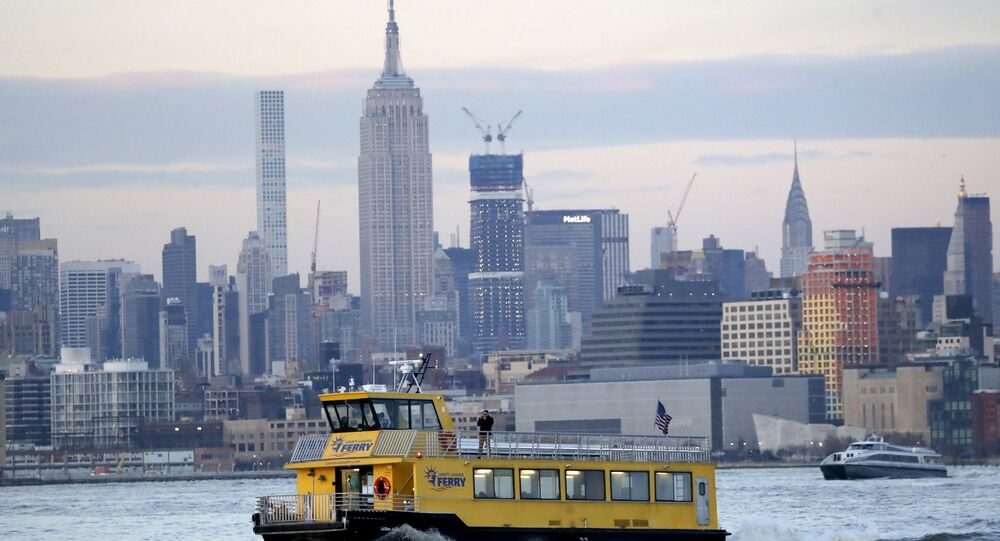 A liberty Landing Ferry boat chugs along the Hudson River with the Empire State Building seen at a distance, Thursday, Feb. 14, 2019