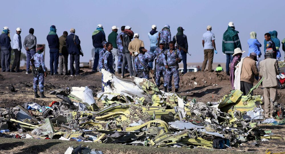 Ethiopian Federal policemen stand at the scene of the Ethiopian Airlines Flight ET 302 plane crash, near the town of Bishoftu, southeast of Addis Ababa, Ethiopia March 11, 2019