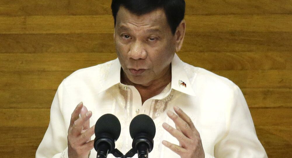 Philippine President Rodrigo Duterte gestures during his third State of the Nation Address at the House of Representatives in Quezon city, metropolitan Manila, Philippines Monday July 23, 2018