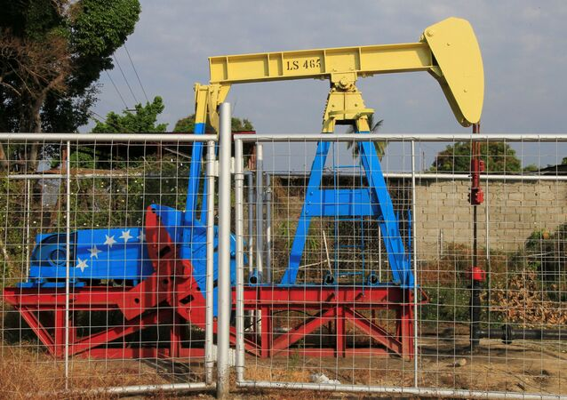 An oil pumpjack painted with the colors of the Venezuelan flag is seen in Lagunillas, Venezuela. File photo