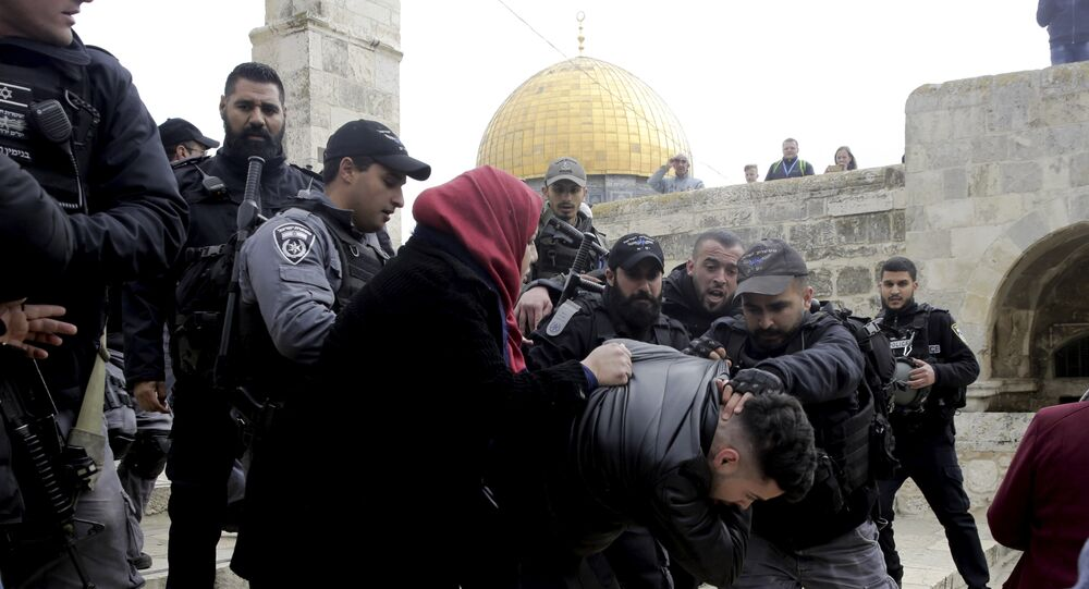 Israeli police arrests a Palestinian in front of the Dome of the Rock mosque in Jerusalem, Monday, Feb. 18, 2019