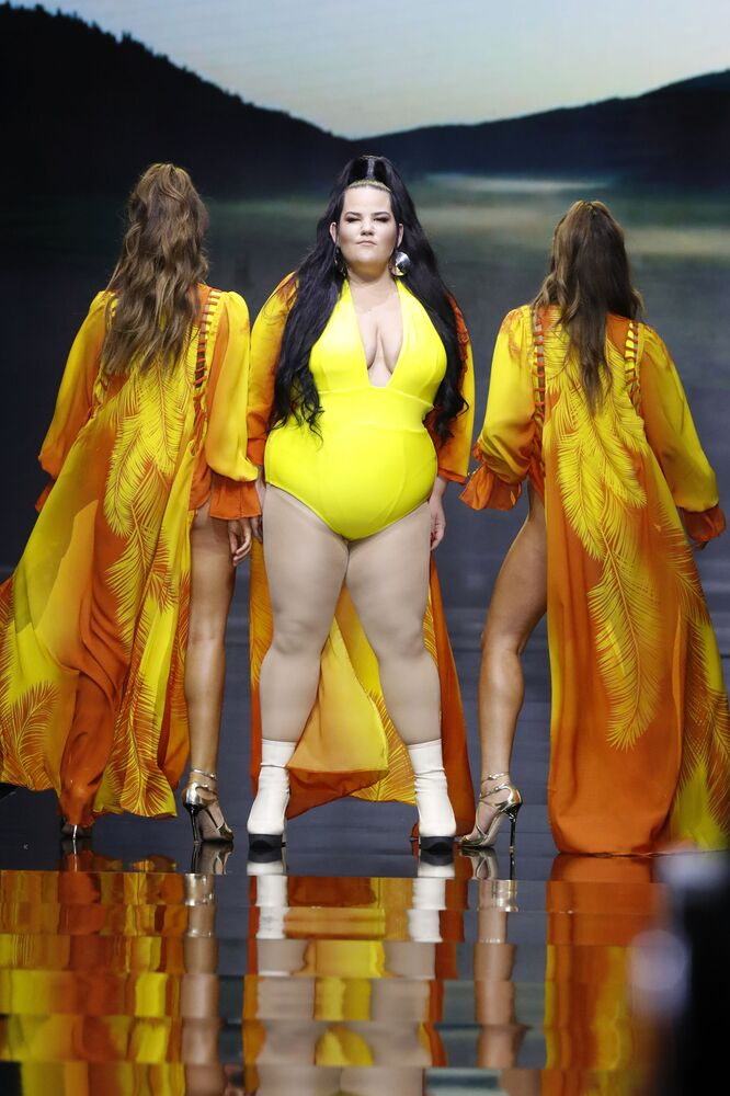 Israeli 2018 Eurovision Song Contest Winner Netta Barzilai (C) Presents a Creation by Israeli Designer Bananhot
