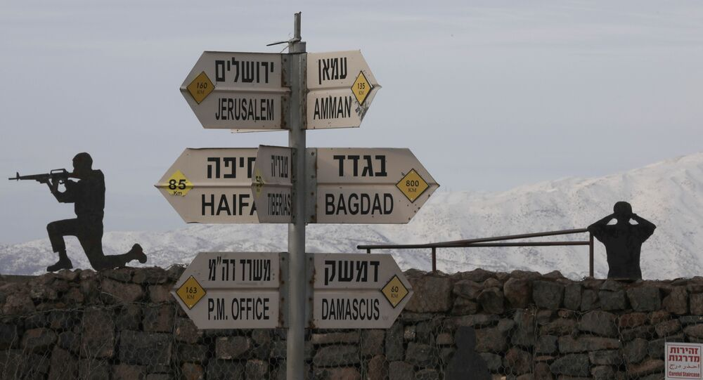 Silhouette sculptures of Israeli soldiers are pictured next to a sign for tourists showing the respective distances to Damascus and Baghdad from an army post on Mount Bental in the Israeli-annexed Golan Heights on January 20, 2019.