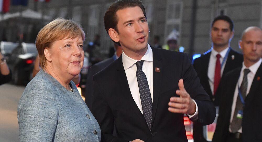 German Chancellor Angela Merkel talks to Austrian Chancellor Sebastian Kurz, right, when arriving at the informal EU summit in Salzburg, Austria, Wednesday, Sept. 19, 2018.