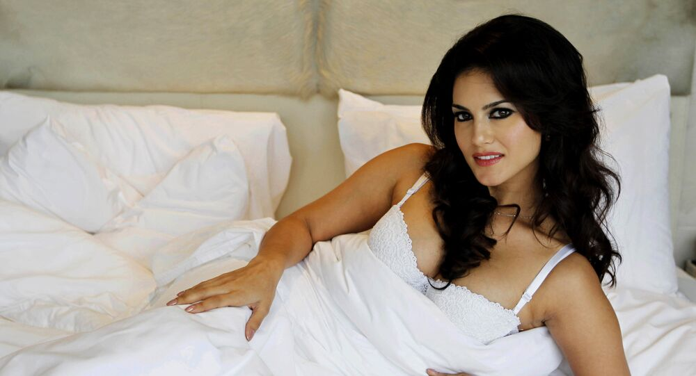 "In this Wednesday, Aug. 1, 2012 photo, hard-core porn actress Sunny Leone, who stars in Bollywood film ""Jism 2"" poses during an event to promote the film in New Delhi, India"