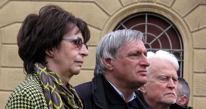 Museum president Daria Bonfietti, left, stands with Don Luigi Ciotti in front of the stage for the Freedom demonstration on 22 March 2015.