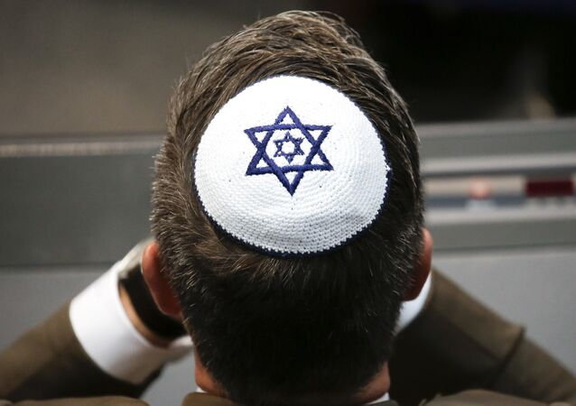 A member of the Christian Union party's faction wears a Jewish skullcaps, or kippa, during a debate at the German parliament Bundestag, about the 70th anniversary of the founding of the state Israel, in Berlin, Thursday, April 26, 2018