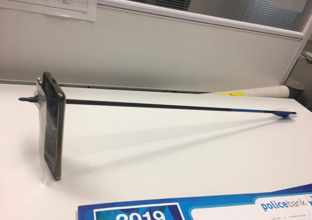 A picture shows an arrow that pierced a mobile telephone after accident in Nimbin, Australia March 13, 2019 in this picture obtained from social media on March 14, 2019.