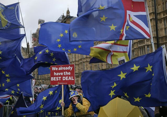 An anti-Brexit pro-remain supporter shouts out during a gathering outside the House of Parliament in London, Tuesday, March 12, 2019.