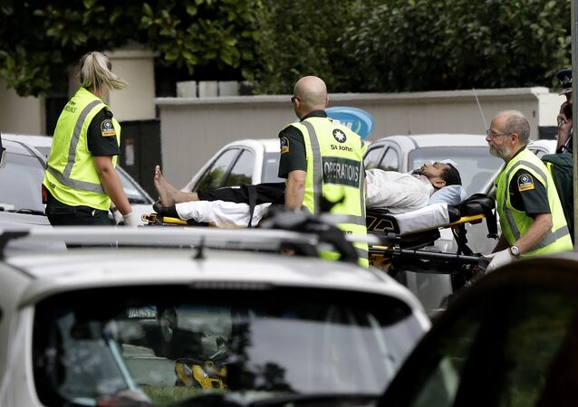 Ambulance staff take a man from outside a mosque in central Christchurch, New Zealand, Friday, 15 March, 2019