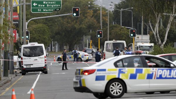 Police block the road near the shooting at a mosque in Linwood, Christchurch, New Zealand, Friday - Sputnik International