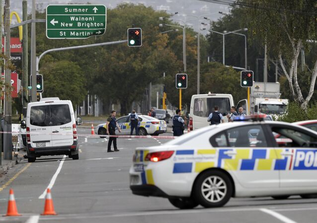 Police block the road near the shooting at a mosque in Linwood, Christchurch, New Zealand, Friday