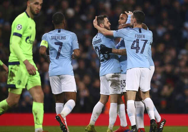 Manchester City players celebrate after they demolished Germany's Schalke 7-0 on 12 March 2019
