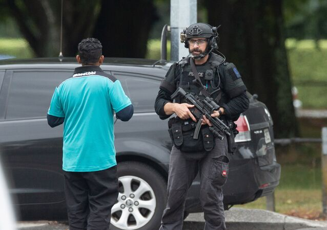 AOS (Armed Offenders Squad) push back members of the public following a shooting at the Al Noor mosque in Christchurch, New Zealand, March 15, 2019.