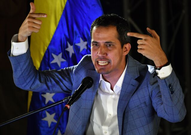 Venezuelan opposition leader and self-proclaimed interim president Juan Guaido delivers a speech during a meeting with local leaders in Caracas, on March 14, 2019. Venezuelans resumed work Thursday after a weeklong hiatus forced by an unprecedented nationwide blackout
