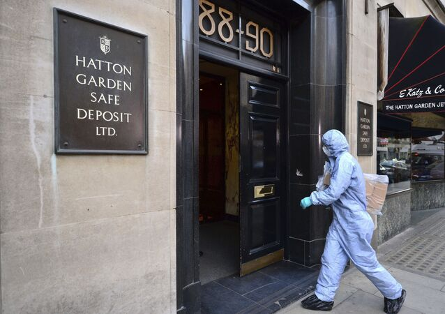 Forensics officers enter the scene of the crime in Hatton Garden, central London in April 2015