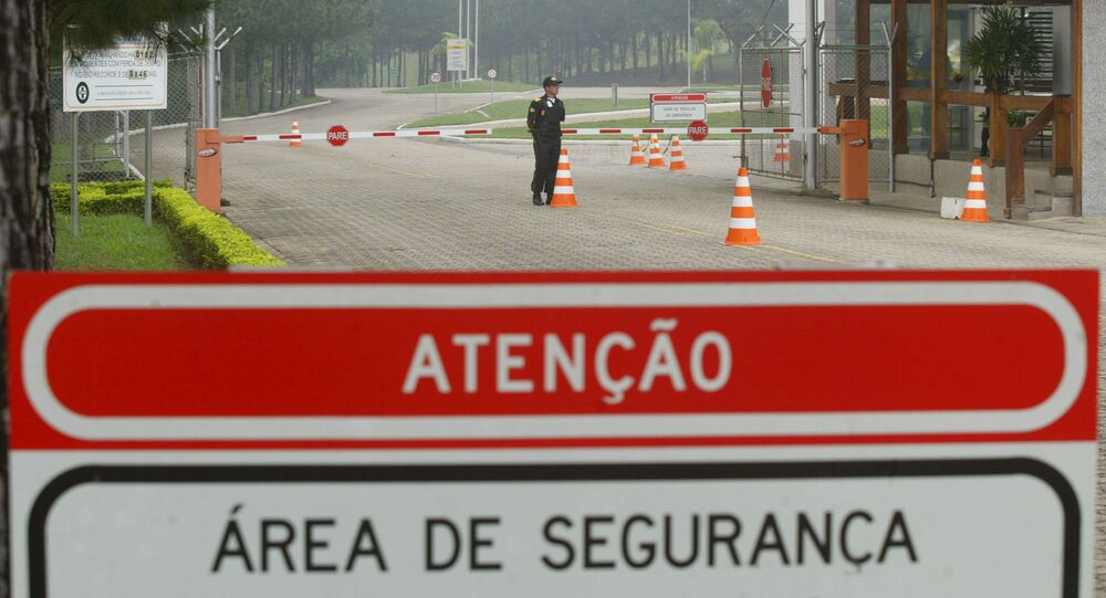 A security guard stands beside the entrance of the nuclear facility, FCN, Fabrica de Combustible Nuclear in Resende, about 100 kilometers (60 miles) northwest of Rio de Janeiro, Brazil, on Tuesday, Oct. 19, 2004