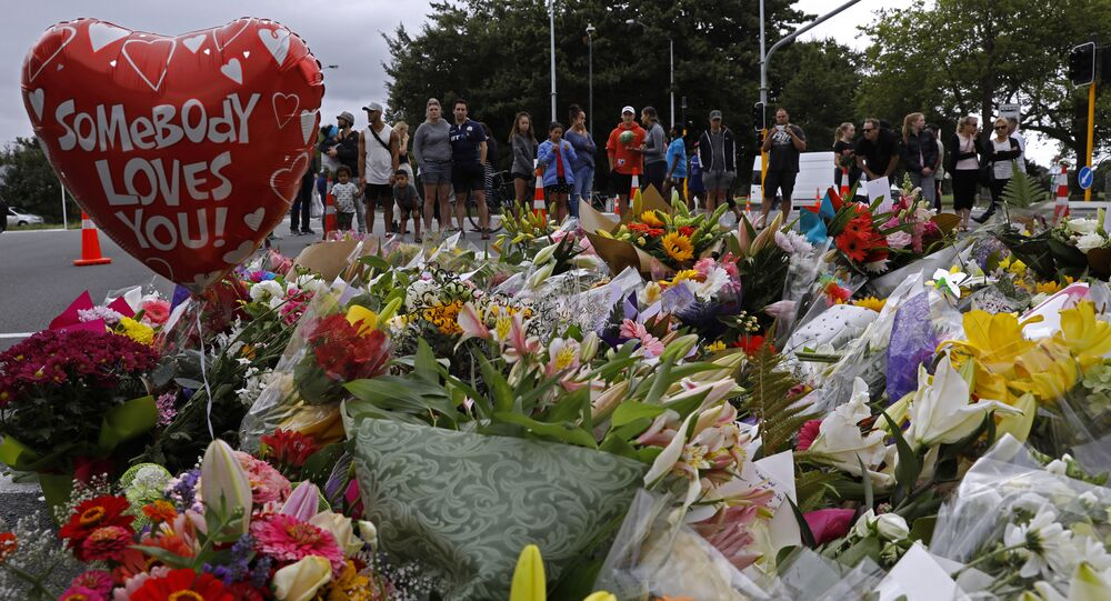 Mourners pay their respects at a makeshift memorial near the Masjid Al Noor mosque in Christchurch, New Zealand, Saturday, March 16, 2019