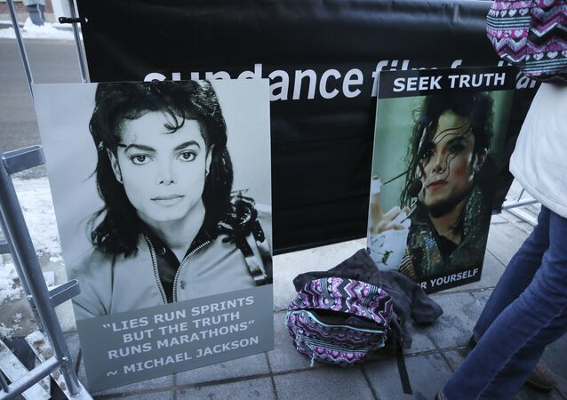 Signs in support of Michael Jackson are seen outside of the premiere of the Leaving Neverland Michael Jackson documentary film at the Egyptian Theatre on Main Street during the 2019 Sundance Film Festival, Friday, Jan. 25, 2019, in Park City, Utah