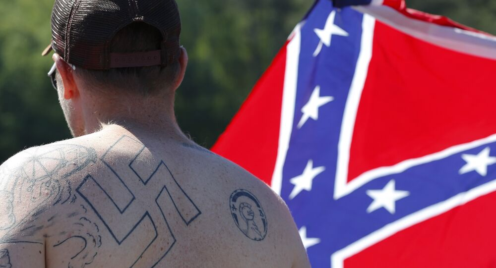 supporters of the US Confederate flag, expecting the Ku Klux Klan to show up, participate in a rally in Georgia