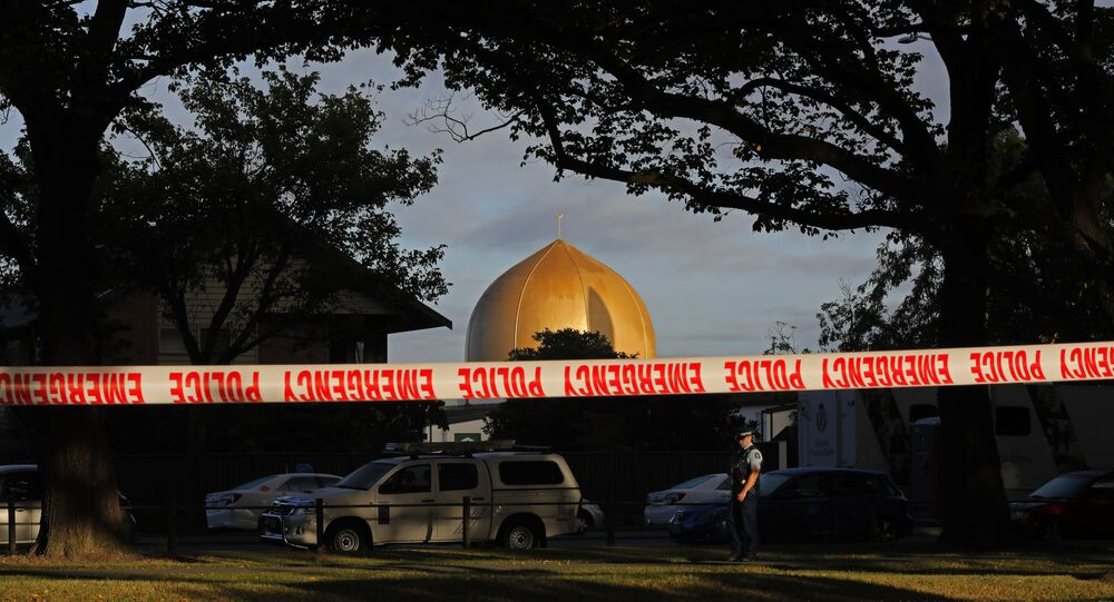 A police officer stands guard in front of the Masjid Al Noor mosque in Christchurch, New Zealand, Sunday, March 17, 2019, where one of two mass shootings occurred