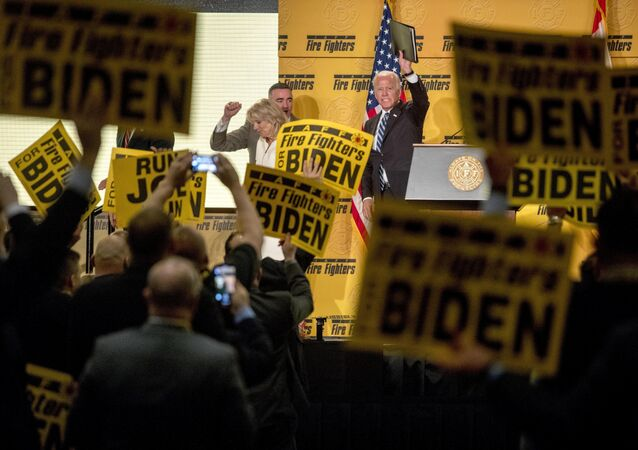 Former Vice President Joe Biden waves as he exits the stage with his wife, former second lady Jill Biden, left, after speaking at the International Association of Firefighters at the Hyatt Regency on Capitol Hill in Washington, Tuesday, March 12, 2019, amid growing expectations he'll soon announce he's running for president