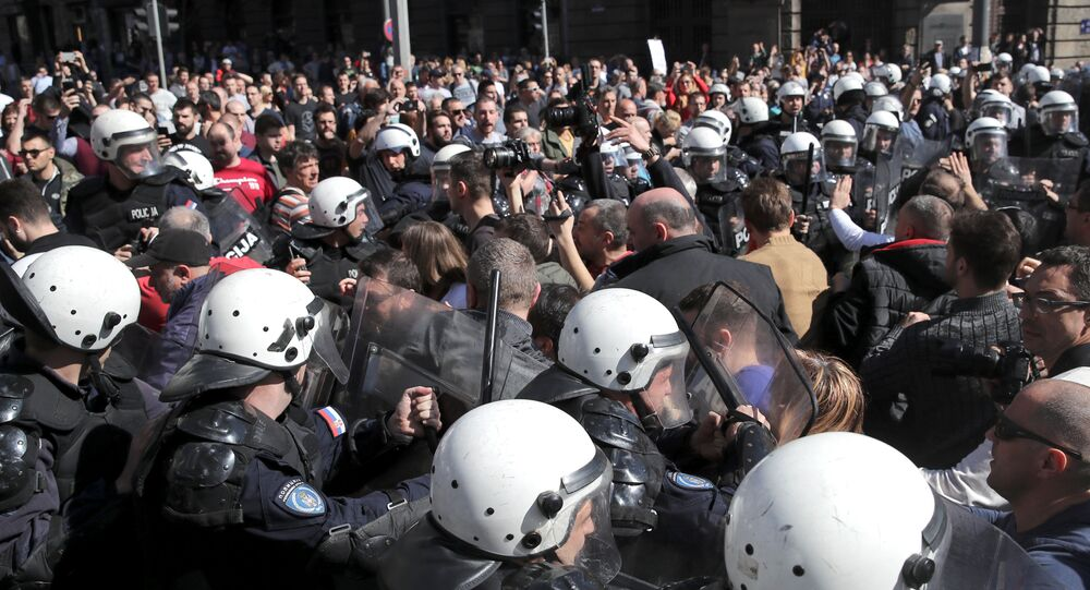 Demonstrators face-off with riot police at a protest against Serbian President Aleksandar Vucic and his government in front of the presidential building in Belgrade, Serbia, March 17, 2019.