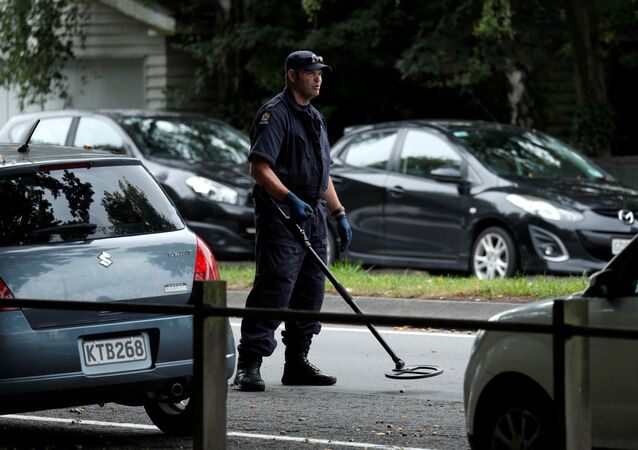 a police officer looks for explosive devices near Masjid Al Noor mosque in Christchurch, New Zealand, March 17, 2019