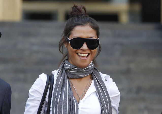 Imane Fadil smiles as she leaves court in Milan, Italy in 2011. Prosecutors have opened an investigation into the 2019 death of the Moroccan model who testified against ex-Premier Silvio Berlusconi