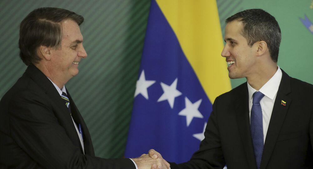 Brazil's President Jair Bolsonaro, left, and Venezuela's self-proclaimed interim president Juan Guaido shake hands, Brasilia, Brazil, Thursday, Feb.28