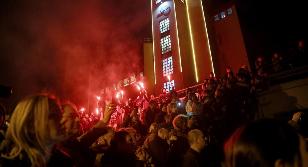 Protesters demonstrate against Serbian President outside the state-run TV headquarters, on March 16, 2019 in Belgrade.