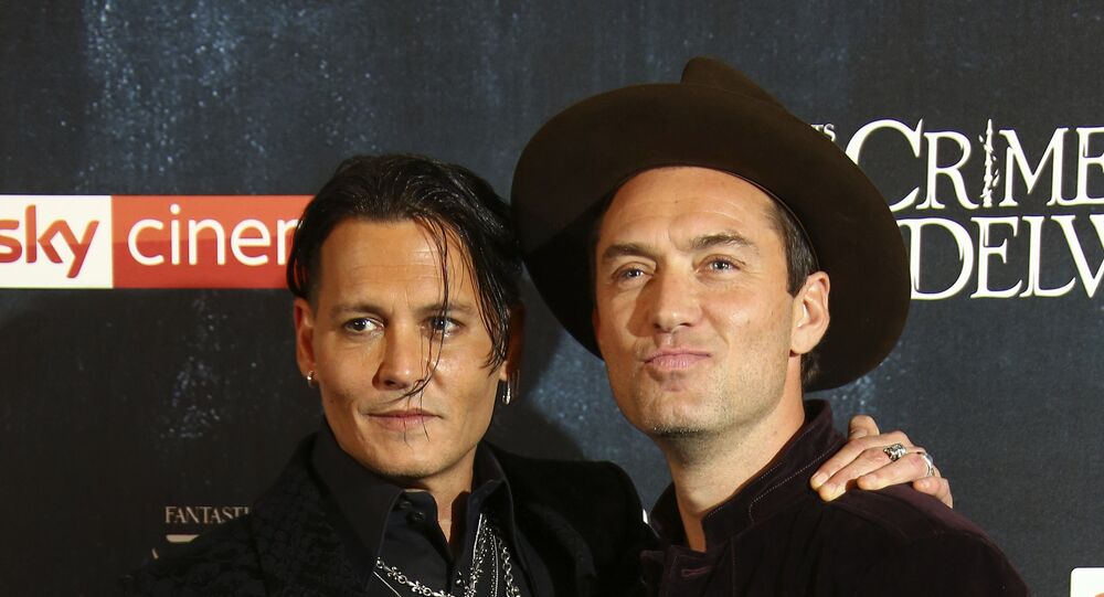 Actor Johnny Depp and Jude Law pose for photographers upon arrival at the premiere of the film 'Fantastic Beasts: The Crimes of Grindelwald', at a central London cinema, Tuesday, Nov. 13, 2018.
