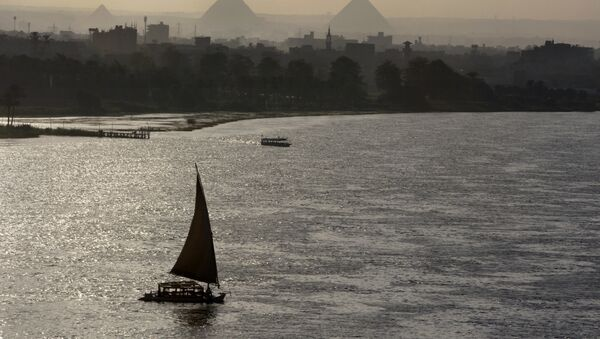 Holiday makers take a boat tour on the Nile River past the Great Pyramids, in Cairo, Egypt, Friday, Aug. 18, 2017.  - Sputnik International