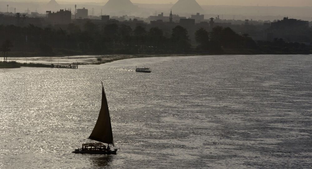Holiday makers take a boat tour on the Nile River past the Great Pyramids, in Cairo, Egypt, Friday, Aug. 18, 2017.
