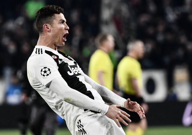 Juventus' Portuguese forward Cristiano Ronaldo celebrates after scoring 3-0 during the UEFA Champions League round of 16 second-leg football match Juventus vs Atletico Madrid on March 12, 2019 at the Juventus stadium in Turin.