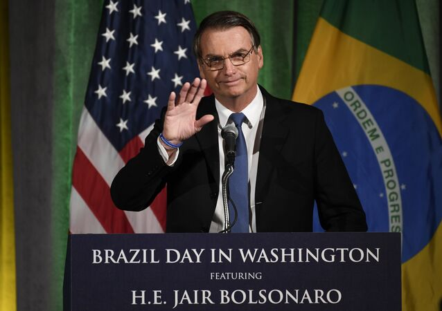 Brazilian President Jair Bolsonaro speaks at the Chamber of Commerce in Washington, Monday, March 18, 2019.