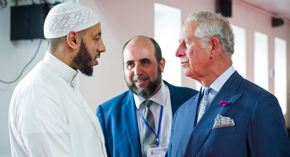 Britain's Prince Charles, Prince of Wales (R) shakes hands with Imam Mohammed Mahmoud (L) as Toufik Kacimi, CEO of Muslim Welfare House (C) looks on during a visit to Muslim Welfare House, in Finsbury near the scene of the Finsbury Mosque attack in north London on June 21, 2017, following a vehicle attack on pedestrians.