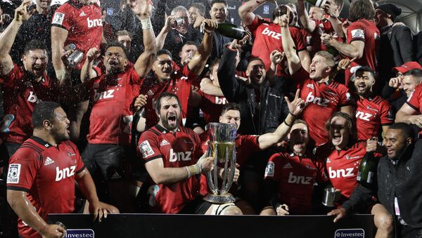 Crusaders players celebrate with their trophy after defeating the Lions 37-18 to win Super Rugby final in Christchurch, New Zealand, Saturday, Aug. 4, 2018 - Sputnik International
