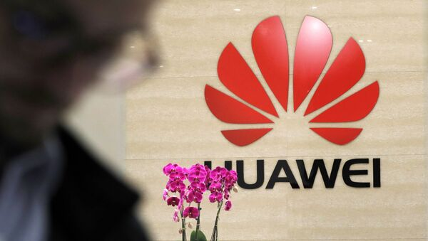 A logo of Huawei hangs in the lobby of the Cyber Security Lab at Huawei factory in Dongguan, China's Guangdong province - Sputnik International