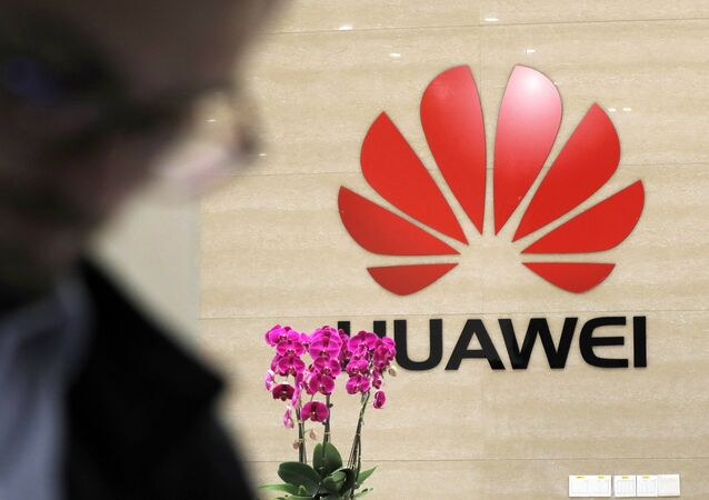 A logo of Huawei hangs in the lobby of the Cyber Security Lab at Huawei factory in Dongguan, China's Guangdong province
