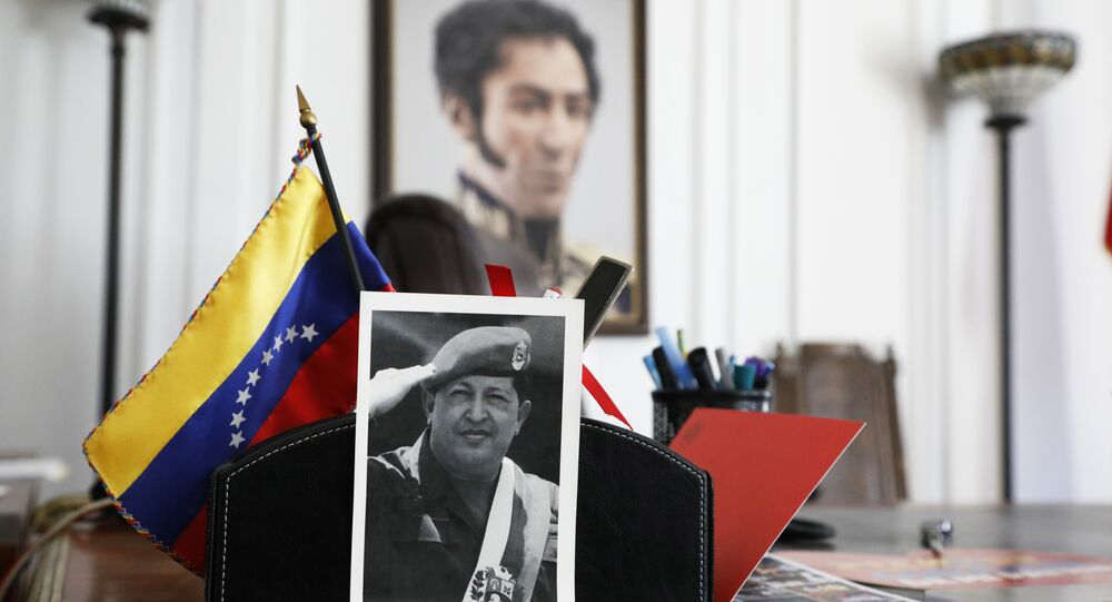 A photograph of Venezuela's late President Hugo Chavez and a painting of Venezuelan independence hero Simon Bolivar sit in an office at the Venezuelan consulate, two days after it was taken over by supporters of self-declared interim president of Venezuela, Juan Guaido, in New York, Wednesday, March 20, 2019. In Caracas, the Venezuelan government of President Nicolas Maduro denounced the forced and illegal occupation of some of its diplomatic headquarters in the United States.