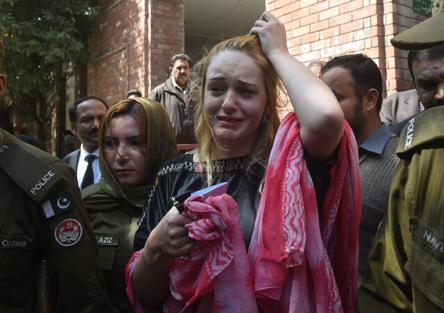 Czech model Tereza Hluskova weeps after the court decision to sentence her to eight years and eight months in prison for attempted heroin smuggling, in Lahore on March 20, 2019. A Pakistan court sentenced Czech national Tereza Hluskova to eight years and eight months in prison after she was found carrying eight and a half kilogrammes of heroin last year from Lahore's Allama Iqbal International Airport.