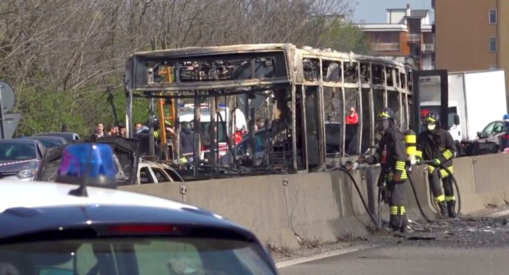 The wreckage of a bus that was set ablaze by its driver in protest against the treatment of migrants trying to cross the Mediterranean Sea, is seen on a road in Milan, Italy, 20 March, 2019