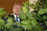 US President Donald Trump steps out of the Oval Office