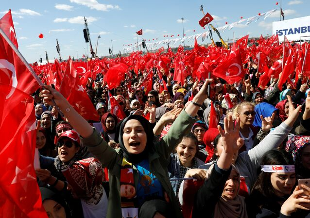 Turkish President Tayyip Erdogan's supporters are seen ahead of a rally for the upcoming local elections, in Istanbul, Turkey March 24, 2019.