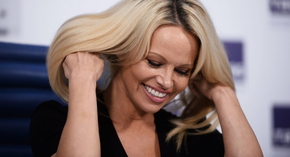 Pamela Anderson, actress and photo model, known for championing animal welfare, seen at a press conference in Moscow