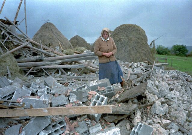 An unidentified Serb woman inspects debris of her home, destroyed in NATO air-strikes in the village of Vidrici, near Sokolac, some 50 kms northeast of Sarajevo Wednesday Aug 30 1995