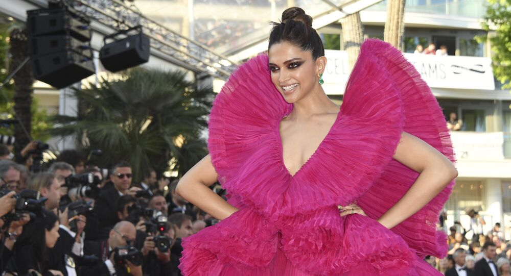 Actress Deepika Padukone poses for photographers upon arrival at the premiere of the film 'Ash Is The Purest White' at the 71st international film festival, Cannes, southern France, Friday, May 11, 2018