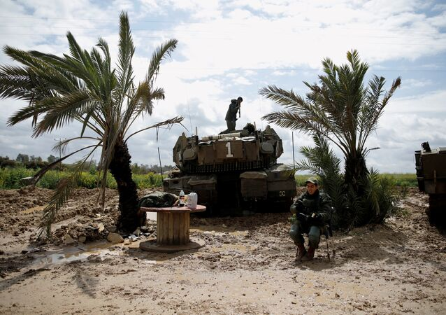 An Israeli soldier stands atop a tank near the border with Gaza, in southern Israel March 25, 2019